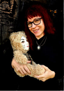 ursula aavasalu with human-faced teddy-doll