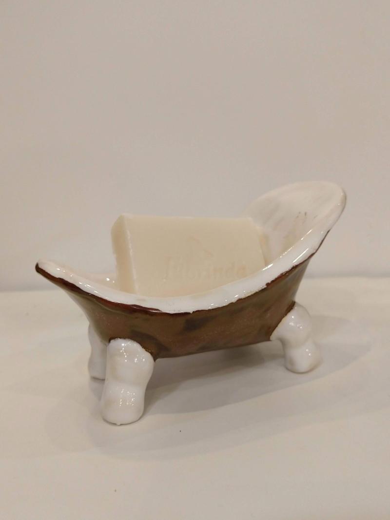 brown bathtub by ursula aavasalu tigukass