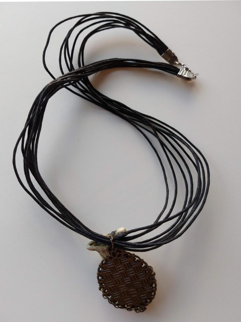 pendant with a joker face by ursula aavasalu tigukass