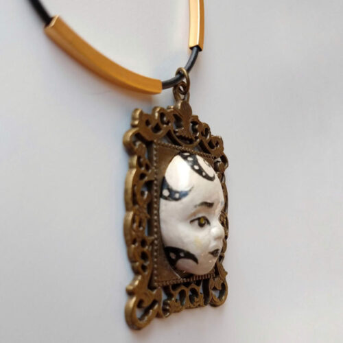 pendant with a thoughtful face by ursula aavasalu tigukass