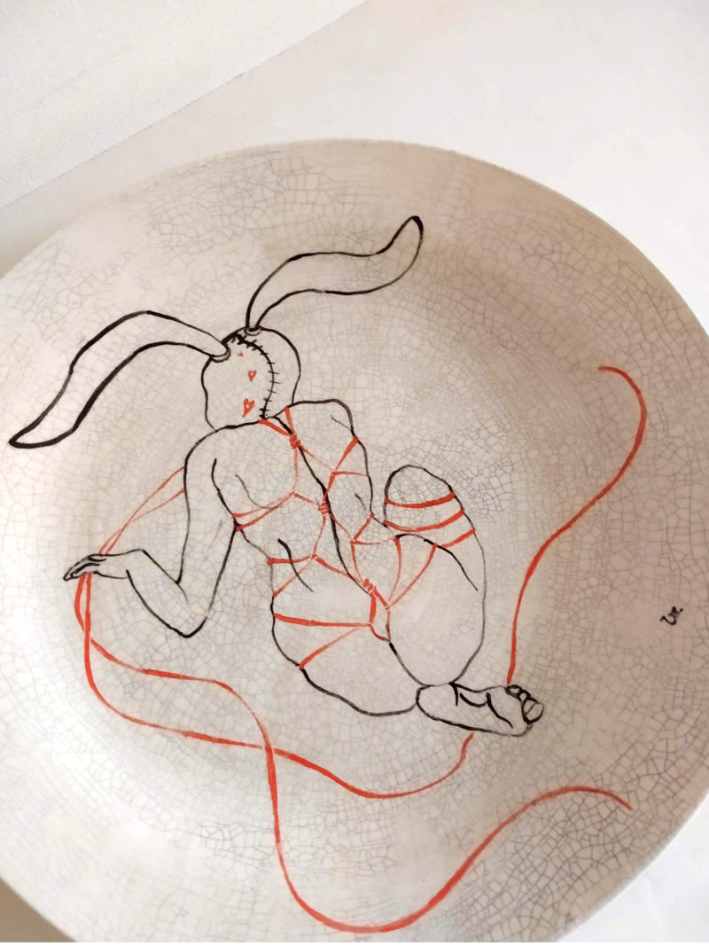 rabbit woman with strings plate by ursula aavasalu tigukass