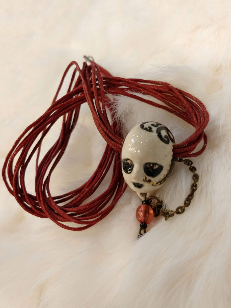 smiling head necklace by ursula aavasalu tigukass