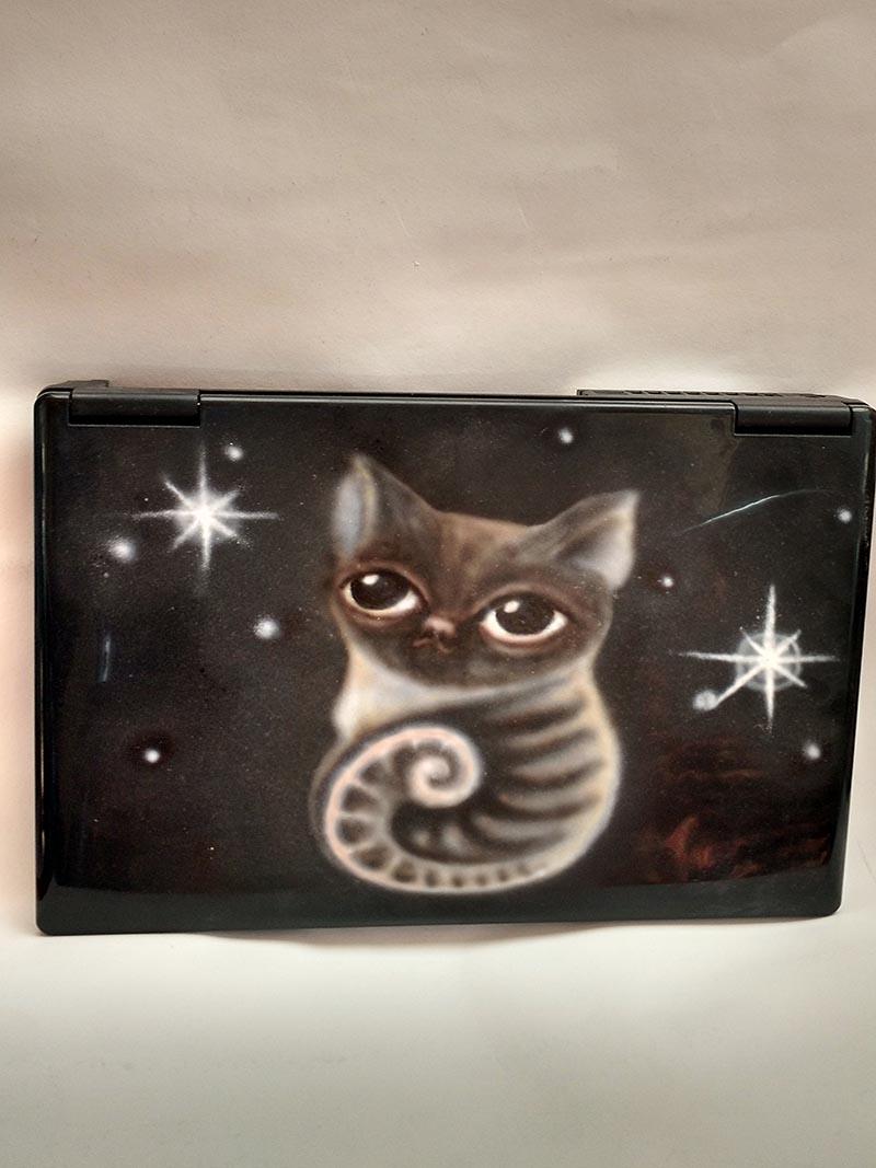 laptop with a cat by ursula aavasalu tigukass
