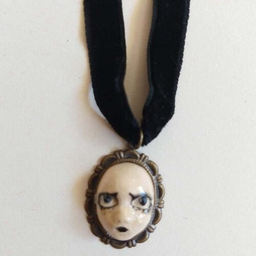 tiny worried- looking necklace by ursula aavasalu tigukass